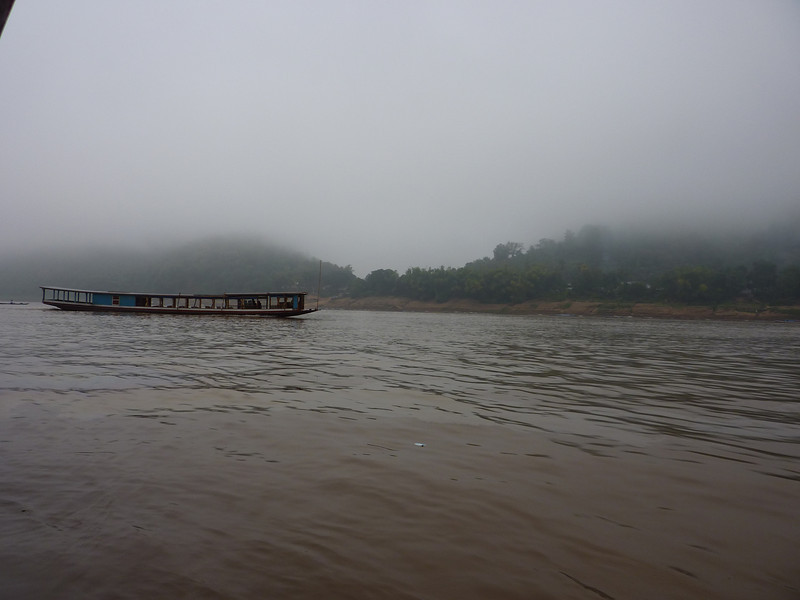 Misty morning on the Mekong River, the boat looks just like the one we were sitting on