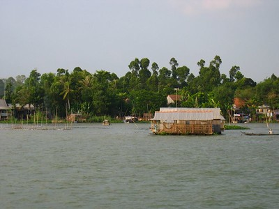house boat... there are fish farms underneath these kind of houses