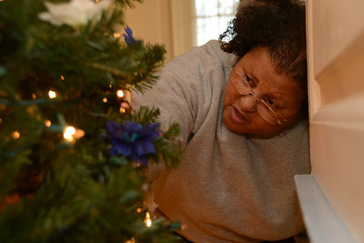 Members of the East Coast Chapter Tuskegee Airmen, Inc. decorate their Christmas tree in preparation for the 2013 Gala.