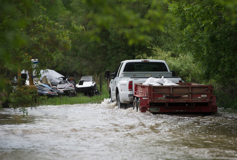 Justin Sheely | The Sheridan Press<br /> A truck hauling sandbags drives up a private street off Leopard Street in Sheridan Tuesday, May 29, 2018. More than two inches of rain fell over Memorial Day weekend causing area flooding near creeks throughout Sheridan County.