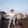 My Aunt Carol, all the kids worked on the farm.  Love the outhouse, and the old pickup.  c.1958