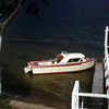 Grandpa's boat parked at the dock in front of his cabin.  If I remember right, Cass Lake, MN. circa1960
