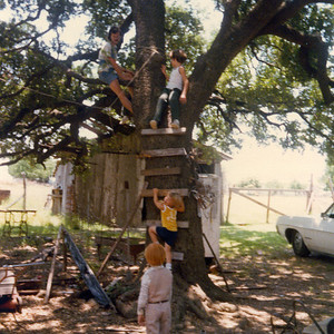 THE CLIMBING TREE This is one of the very few pictures I have of our beloved climbing tree at Grandpa's. Here I am giving instructions to the wee ones, some of whom I can't remember. I think that's my nephew Matt in the foreground.