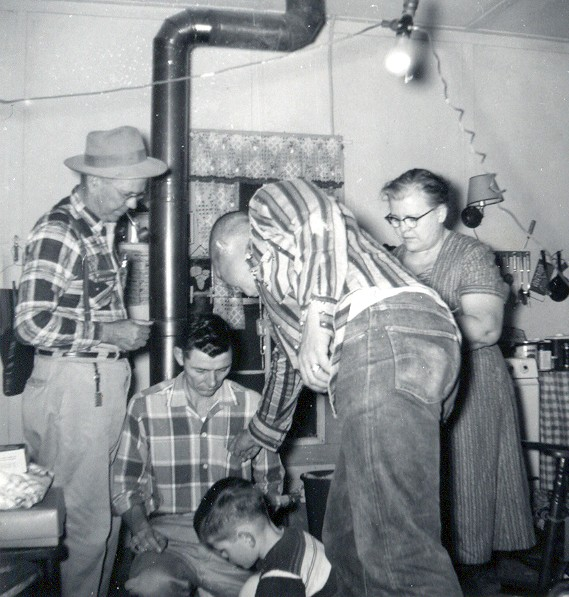 IN THE KITCHEN<br /> This is where life was held in the Moore household, right here around the wood stove and the kitchen table. L to R: Grandpa, Dad, me, Uncle Sonny, and Nano. This photo was taken in 1959.
