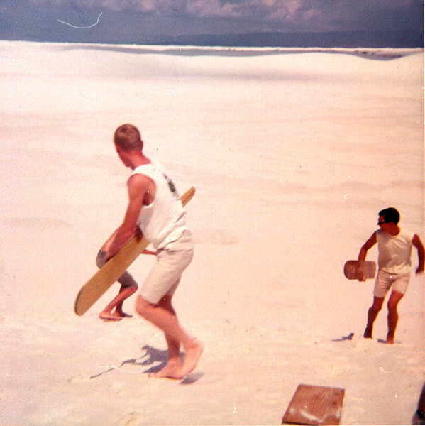 SANDSURFING AT WHITE SANDS, NM<br /> Here are my cousins Rick (the blonde guy) and Greg (hidden behind Rick) at the White Sands National Monument in NM doing something I've never done before -- surfing on sand. Totally tubular, dude!