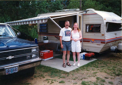 TRAILER DAYS My girlfriend Lisa and me in front of our -- actually her -- trailer at the Manor RV Park in Estes Park, Colorado. We met when we worked for the concessionaire at Mt Rainier National Park and, as far as I'm concerned, it was love at first sight. Having had enough of the underhandedness of the company, we bought the Chevy Blazer, hooked up the trailer, and hit the road. We would travel all over the country for the next four years, working seasonally in various parks, campgrounds, and hotels, living out of this little aluminum box we called home. It was some of the best years of my life.