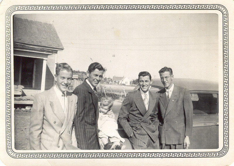 THE DUNCAN GANG<br /> An undated photo of my dad and his three brothers. L to R: Gayle, Linuel, unknown child (probably Linuel's daughter, Carol), Dad, and Loyd. Look at those suits, would you?