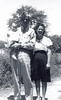 THE DUNCAN FAMILY<br /> A shot of Mom and Dad and my older sister, Lyn, taken in Lometa in 1945, I'm guessing. Dad was still in the service, Lyn was born in April 1944 and looks to be about a year old here, and it looks like springtime in Lometa to me. Brilliant! (Elementary, dear Watson.)