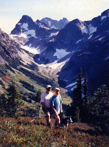 "IN THE NORTH CASCADES Me, my girlfriend Lisa, and our dog, Clea, in the North Cascades near Mt Baker. We had just hiked up Easy Pass with friends and fellow RV-ers Roger and Maria, which was no easy feat. We decided to rename the trail ""Easy-my-ass Pass,"" as that seemed much more appropriate. This would be our Christmas card shot this year, 1996."