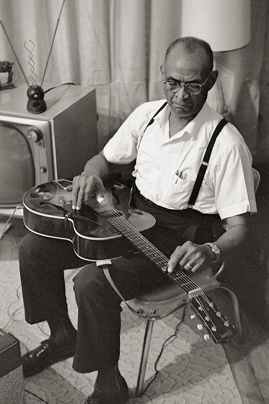 "Rev. Robert Wilkins at home.  His recording of ""Prodigal Son"" was covered by the Rolling Stones."