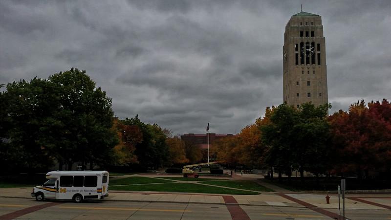 U of M bus with Burton Memorial Tower.