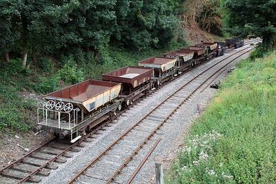 Wymondham siding holding 6x Dogfish DB993218, DB988003, DBDB993580, DB993451, DB993116, DB983913 and 2 x Burnt out wagons B741748 and B730006.