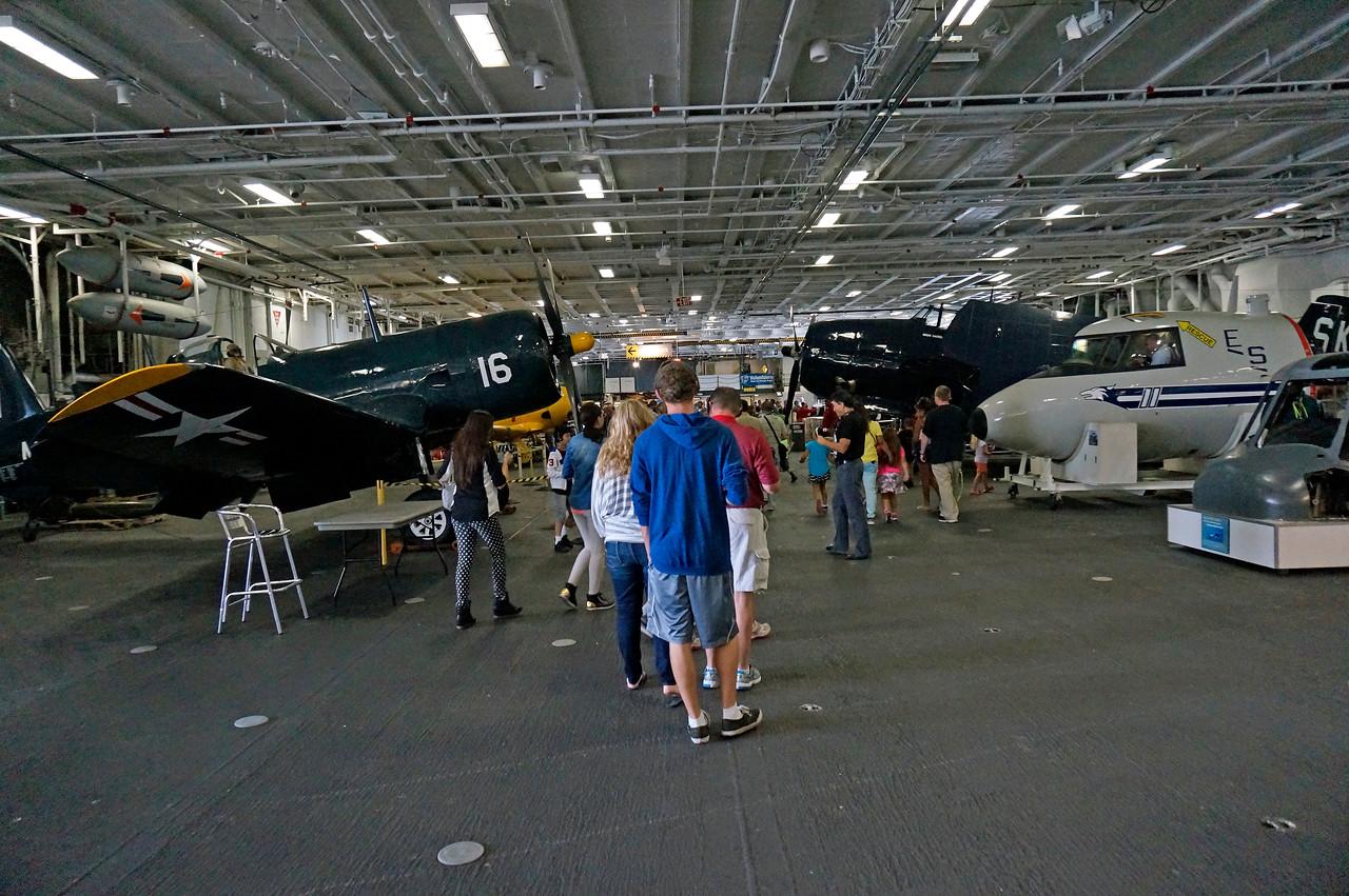 Hanger deck. F4U Corsair on the left, TBF Avenger on the right.
