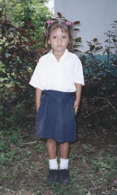 """This is Alexandra from Nicaragua.  She is the sponsored child of the Lawrence family.  For a relatively small quarterly sum, Alexandra's education and her family's well-being is assured.  The Lawrence's keep in periodic contact with her through correspondance with her family through the Childreach organization and have the joy of seeing her grow and prosper.  In this very modest way, it is hoped that the message of Baha'u'llah --- <I>We prescribe unto all men that which will lead to the exaltation of the Word of God amongst His servants, and likewise, to the advancement of the world of being and the uplift of souls. To this end, the greatest means is education of the child. To this must each and all hold fast. """" </I>---  will be furthured.  Click on this <A HREF=""""http://www.childreach.org/"""">http://www.childreach.org/</A> for information about this very worthy program."""