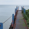 A walkway along the breakwater at the harbor.