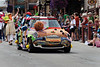 The Blazing Needles yarn graffiti Mini Cooper makes its way down historic Main Street as a huge crowd packs Historic Main Street for a parade as Park City, Utah celebrates its mining heritage every Labor Day with traditional Miner's Day celebration produced by the Rotary Club of Park City. (c) 2011 Tom Kelly