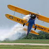 John Mohr flies his 1943 Stearman just above the runway during Saturday's air show.