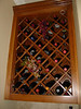 Alder cabinet with traditional wine grid