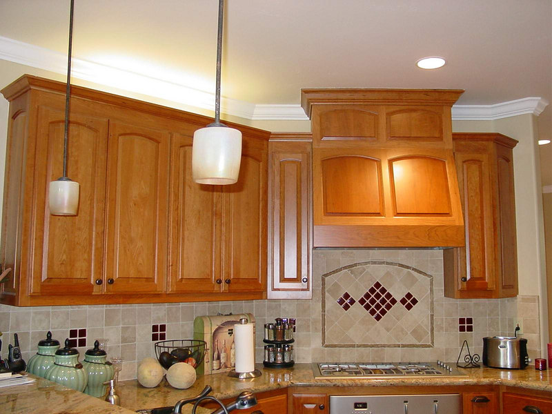nine foot ceiling with Cherry Hood Enclosure over stove