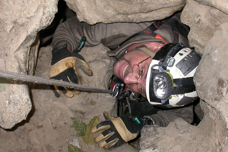Brent slithering out of Flowing Stone Cave, a 224 foot pit near La Fayette, GA.