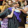 ERHS Principal Eric Baylor presents a diploma and hugs the parents of Ethan Zander.