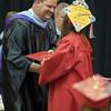 ERHS Principal Eric Baylor presents a diploma.