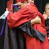 ERHS Principal Eric Baylor hugs a student after presentation of diploma.