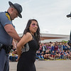 Trooper Nathan Lawson places ERHS Student Norma Morris under arrest for driving under the influence.
