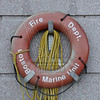 Life saving ring located on the wall outside of Boston Marine 1's quarters.