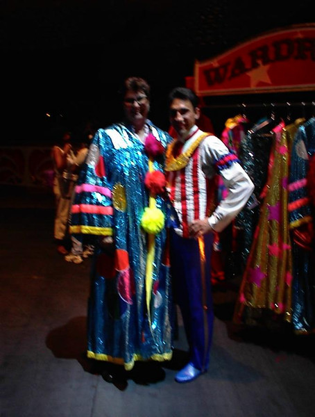 My Mother and I went to Ringling Brothers circus (4 Aug 2000), and during the part before, people were allowed to try on a few fancy capes (with one of the dancers). Photo taken Aug 2000.