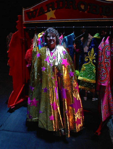 My mother Eleanor Griffy and I went to Ringling Brothers circus (4 Aug 2000), and during the part before, people were allowed to try on a few fancy capes. Photo taken Aug 2000.