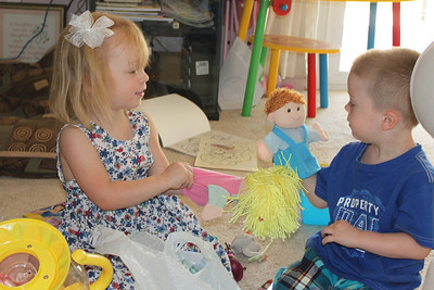 Ashley and Peyton are playing with the puppets that I got at the Dollar Store because they reminded me of Ashley and Peyton.
