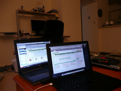 Working late. Left to Right, Dell 620 (eh), Macbook black (obviously, <3!), Alienware M5790 (meh).