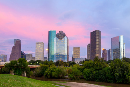 37317252 - houston, texas  skyline at sunset twilight from park lawn