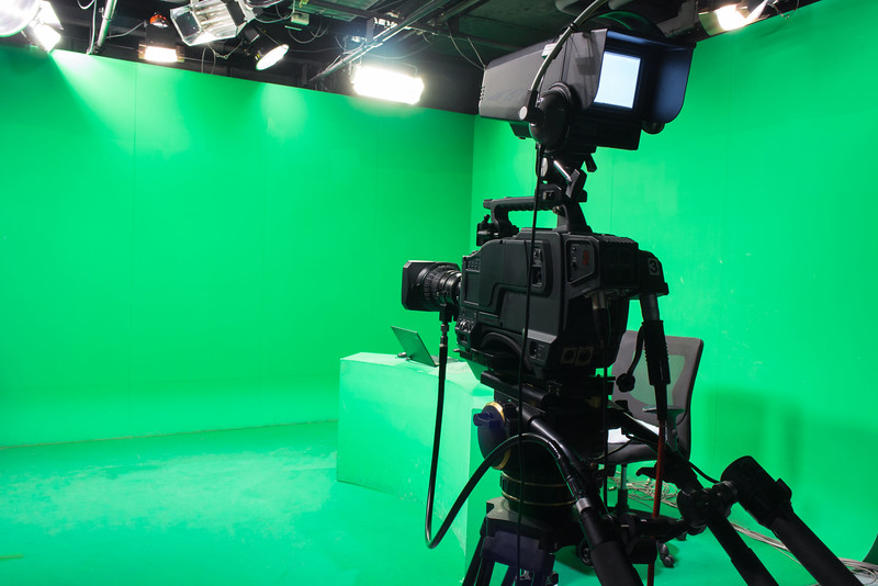 36007775 - television studio with camera and lights - camera on tripod: shallow depth of field