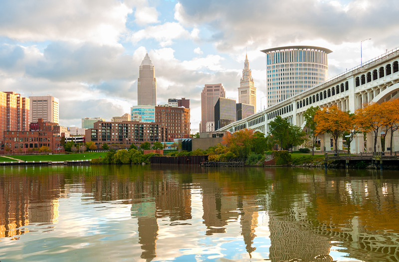 34068652 - downtown cleveland ohio rises above the cuyahoga river at heritage park in morning light