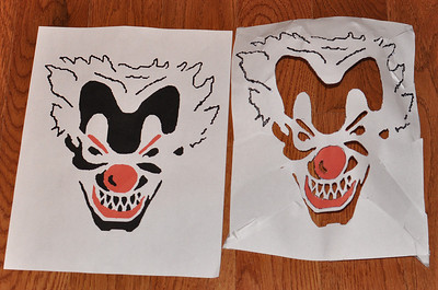 This is the pattern created for the 2011 addition to the pumpkin collection.  On the right is the image transfer.  I cut out the removal areas in order to draw the image directly only the pumpkin for later Dremeling.  It was somewhat therapeutic taking a sharp image to a clown face!  Note, base image created from a picture in Google Image cache.  The patternized pumpkin image is not for sale and all image rights remain with original image creator.