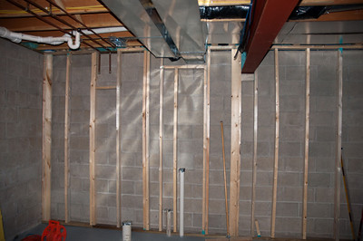 A closer look at the South wall where the bathroom will be - nightmare trying to get the framing around all the heat ducts and plumbing.  Needless to say the plumbing on the floor was to be contended with since you couldn't just raise the wall up (studs on other side of the pipes).  Basically had to build it in place small sections at a time.