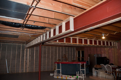 Basement framing - can see the South wall as well as some of the beam ladders
