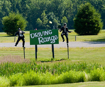 How about some interesting signage.  You never know what you are going to see traveling the roads of this great nation.  Take for instance this particular scene.  Someone decided that a simple Driving Range sign just didn't have the marketing grab needed to sustain their business.  What better way to get eye traffic than to dress it up with …. statues of the Blues Brothers in full dance position.  How ironic that we drive all the way out to Maine and what do we see but an icon of a city (Chicago) only three hours to the North of where we live.  For the record, a split second later on the shutter and it would have been perfectly anchored by the two evergreens resulting in an A+ for Phoadtography composition!