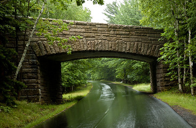 Here is another stone bridge in the heart of Acadia.  It is definitely more square that most stone bridges I've come across but does solve the problem of the clearance at the edges of the road (as in the sides of the bridge).  There is a slight optical illusion in this picture because it looks almost flat across the top of the opening, but in reality, the interior of the bridge does have a more of an arch built into it providing the required strength.  To be honest, this is one of my favorite Phoadtography shots to date with the lush greens of the trees, the nice composition of the bridge and the shimmer off of the wet roads.  Not bad considering it was taken in the car through the front windshield on a pretty overcast and icky day.