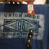 "Dear Target Australia, is this TShirt actually ""union made""? As it's labelled as ""made in Bangladesh"", I would say it's safe money to summise no union conditions were involved in its manufacture. If I'm wrong, I'm happy to stand corrected, but I think it's really just a few words used to flog a piece of fabric made for twenty cents in a sweatshop far away. Awaiting your reply, Scott<br /> — at Northgate Shopping Centre."