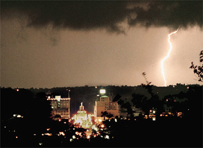 A storm moves in from the west, beyond downtown Hamilton.