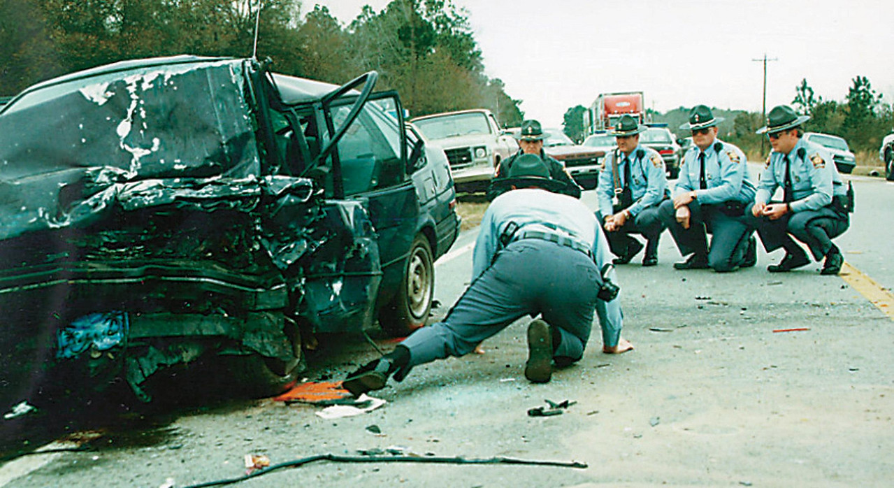 Georgia State Troopers examine the scene of a double fatality.