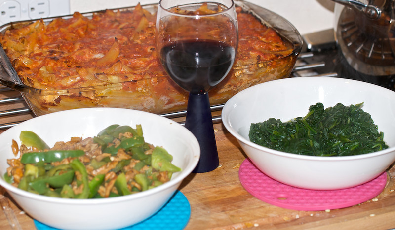 Baked ziti with homemade ricotta; mozzarella, grans padrano, and hot sausage.  Side dishes are green peppers with chanterelles and steamed spinach.  And a glass of 2005 Valley of the Moon Sangiovese.
