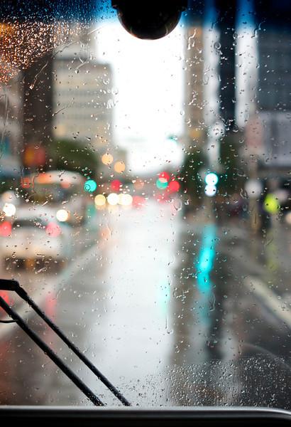 Bus ride into the city on a rainy day ref: e0c01c07-794f-477c-8749-75e76b2a3620