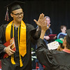 Two ERHS student high five each other during the commencement cermony