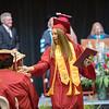 Natile Jenkins high fives a classmate after receiving her dipolma