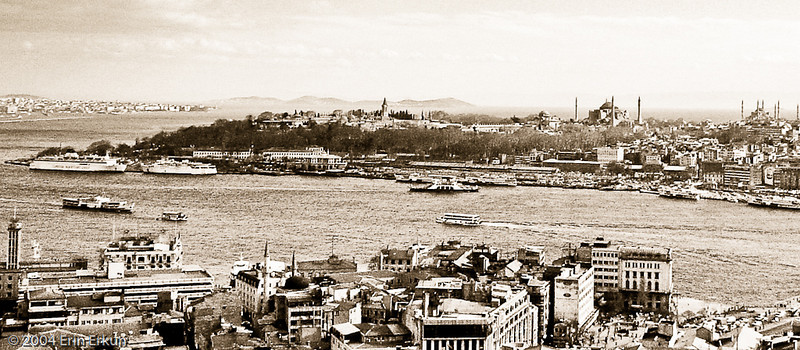 March 2004<br /> View from Galata Kulesi (Galata Tower)<br /> View of Seraglio Point (Sarayburnu) where the Topkapı is located, followed by (left to right) the Hagia Sophia and the Sultan Ahmet (Blue) Mosque. The Sea of Marmara and the Princes' Islands are seen in the background, on the horizon.