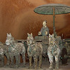12 December 2002<br /> Terracotta Warriors Exhibit - Splendid China, Orlando, Florida<br /> Replica of bronze chariot found in Pit 3. The umbrella is a good indication that this was not a chariot of war.